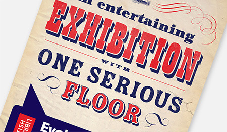 Close crop of a typographic poster, with the words 'An entertaining exhibition with one serious floor'.