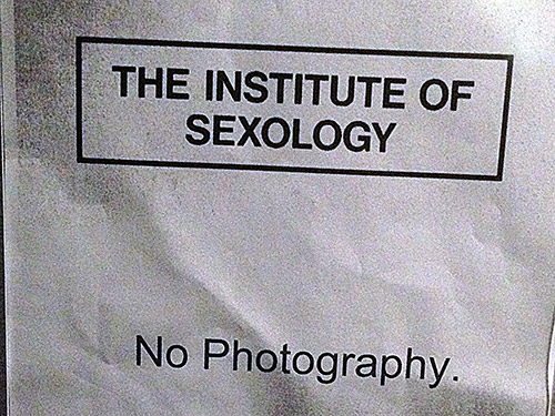 A distressed photocopy which reads The Institute of Sexology - No Photography