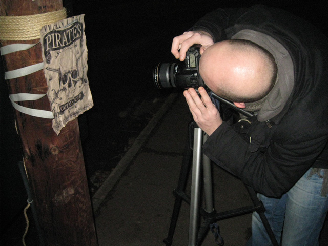 Photographing the 'poster', outside our studio on a cold winter's night.