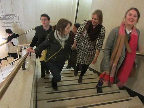 The Cog team on a set of stone stairs,on their way up to the exhibition.