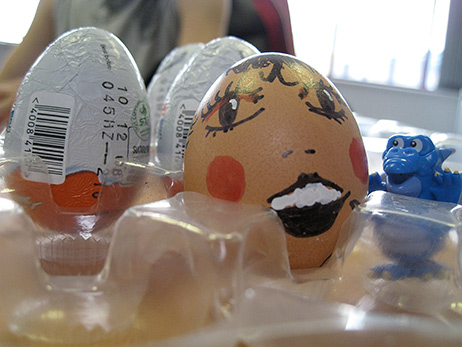 The egg, painted and ready to be dropped, together with Kinder Egg prizes for the winners.