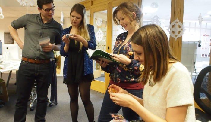 The Cog team, studying the Secret Santa presents