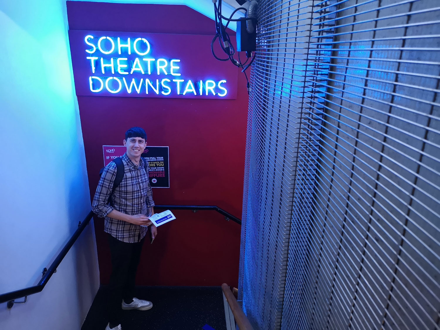Nick from Cog poses in front of a sign that reads Soho Theatre Downstairs